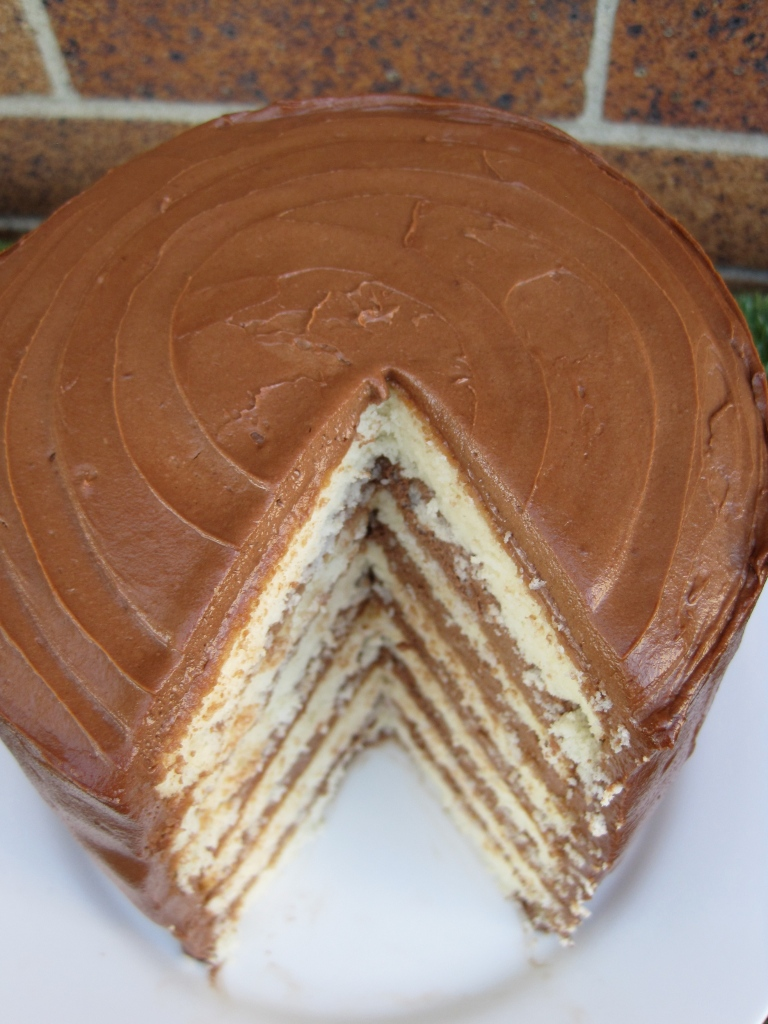 vanilla buttermilk six-layer cake with chocolate frosting by the baking cup